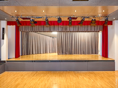 Stage curtains and stage curtain rails, Schönberg Community Centre in the Stubai Valley