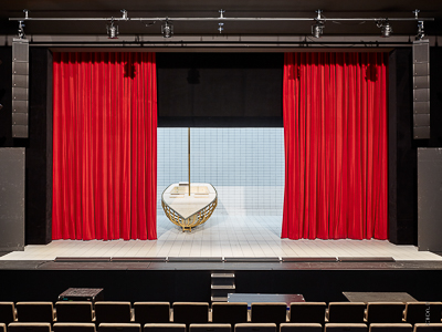 Main curtain, curtain track system and electric roller screens 9x9m - House of Music, Innsbruck